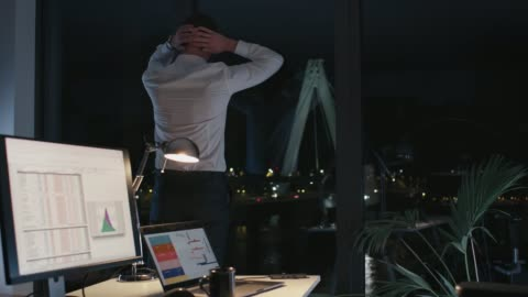 young businessman working late in office - stretching stock videos & royalty-free footage