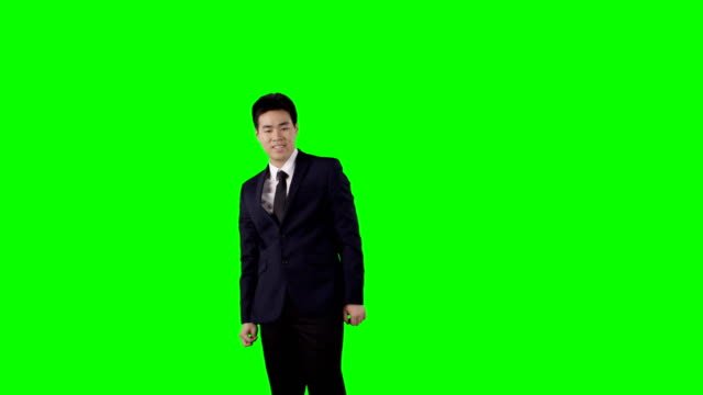 young businessman working on a touch screen. green screen with alpha - arms raised stock videos & royalty-free footage