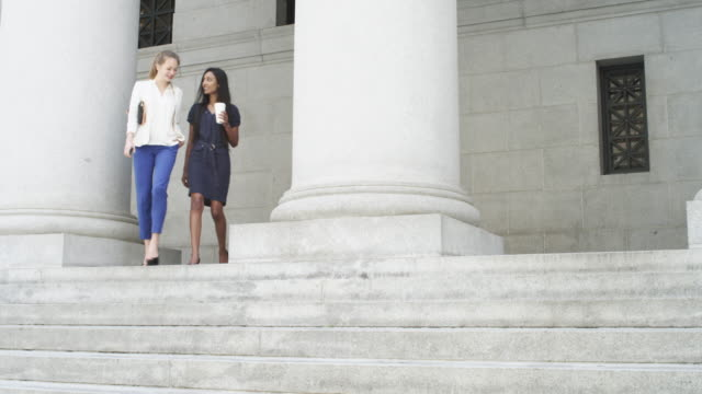 young businesspeople sitting on steps during lunch break - lunch stock videos and b-roll footage