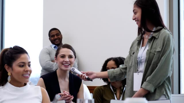a young businesswoman asks a question during a panel discussion - candidate stock videos & royalty-free footage