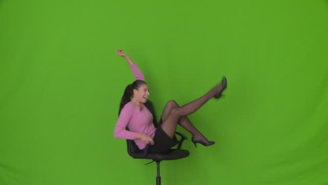 young businesswoman dancing with office chair - chair stock videos & royalty-free footage
