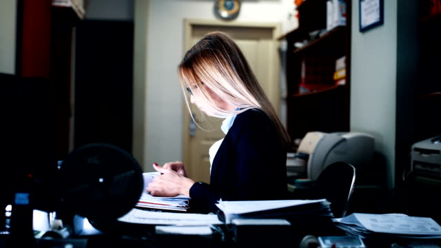 young businesswoman doing paperwork in office - administrator stock videos and b-roll footage