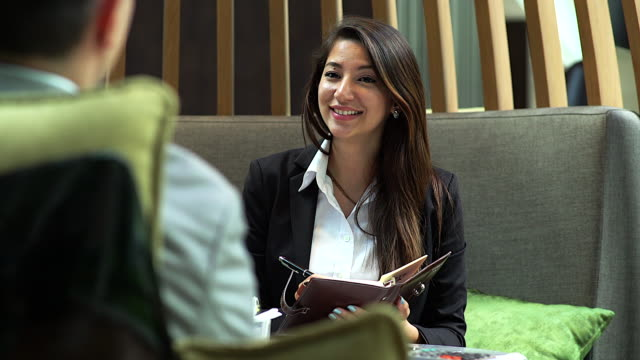 4K :Young businesswoman during job interview at the coffee shop.
