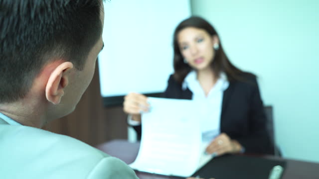 4K : Young businesswoman during job interview at the office.