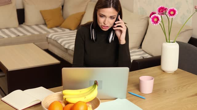 young businesswoman having a business talk at her home office - business talk stock videos & royalty-free footage