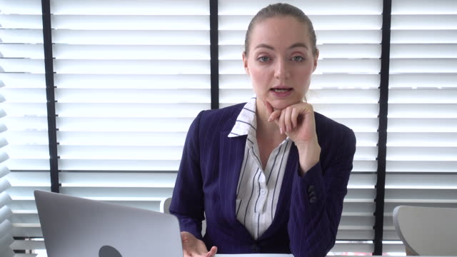young businesswoman having video conference - only young women stock videos & royalty-free footage
