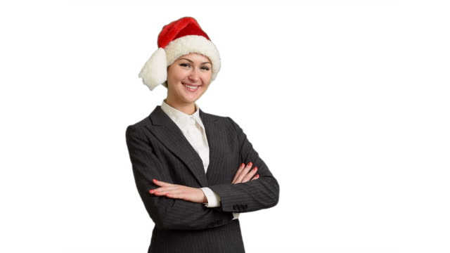 young businesswoman  in suit and santa hat on a white screen - santa hat stock videos and b-roll footage