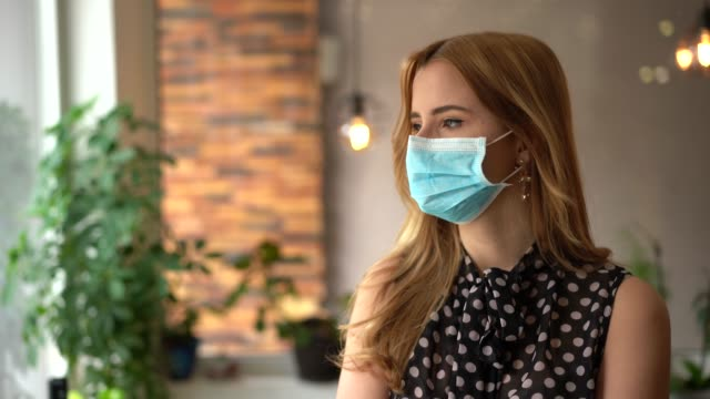young businesswoman looking at camera - pollution mask stock videos & royalty-free footage