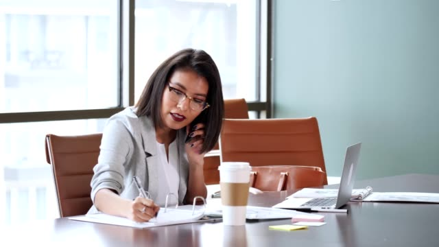 young businesswoman on business call - reading glasses stock videos & royalty-free footage