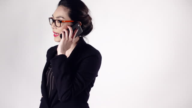 Young Businesswoman talking on mobile phone.