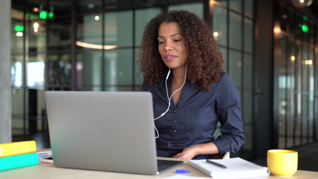 young businesswoman using laptop for a video call - serious stock videos & royalty-free footage