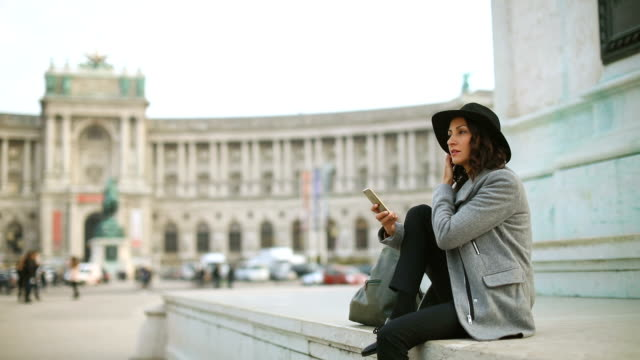 young businesswoman using phone in vienna ,austria - traditionally austrian stock videos & royalty-free footage