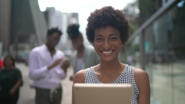 young businesswoman using tablet portrait on the city - pardo brazilian stock videos & royalty-free footage
