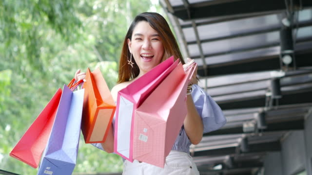 young businesswoman very cheerful with shopping bags