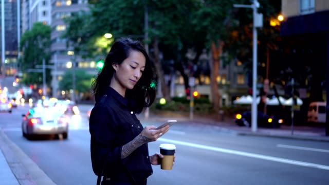 young businesswoman waiting for taxi in sydney - road stock videos & royalty-free footage