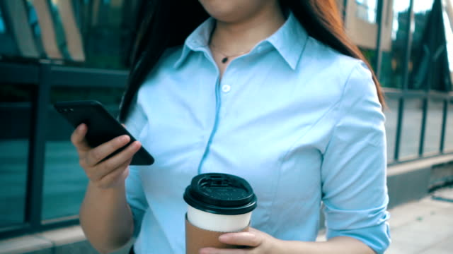 young businesswoman walking,holding coffee and phone - lunch stock videos & royalty-free footage