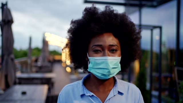 young businesswoman wearing protective mask - slow-motion stock videos & royalty-free footage