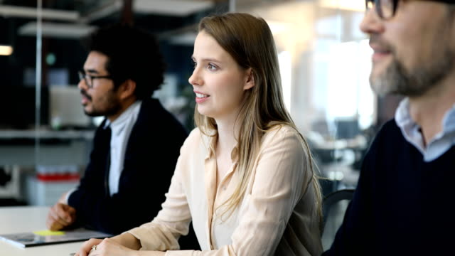young businesswoman with coworkers in meeting room - small group of people stock videos & royalty-free footage