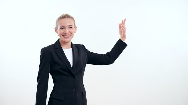 vidéos et rushes de jeune femme d'affaires avec porte-voix sur fond blanc - port saïd