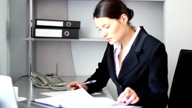 young businesswoman working at the office. - domestic staff stock videos & royalty-free footage