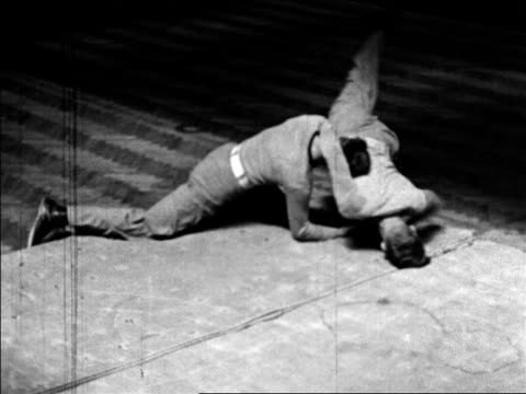 b/w 1920 2 young cadets wrestling / west point, ny / documentary - ウェストポイント点の映像素材/bロール