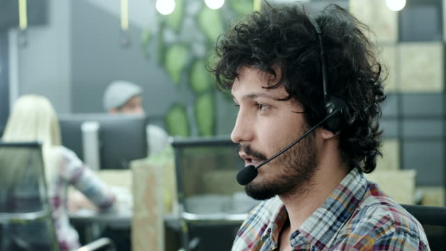 young call-centre assistant - headset stock videos & royalty-free footage