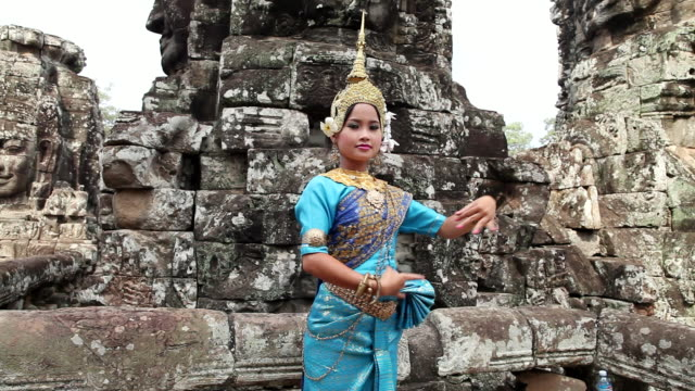 ms young cambodian girl performing  khmer dance in front of e bayon temple / siem reap, siem reap, cambodia - cambodian culture stock videos and b-roll footage