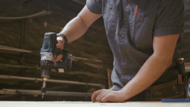 young carpenter drilling (slow motion) - trainee stock videos & royalty-free footage