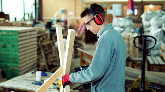 young carpenter working in workshop - carpentry stock videos & royalty-free footage