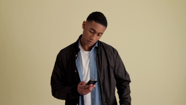 mws young casual man on phone - raised eyebrows stock videos and b-roll footage