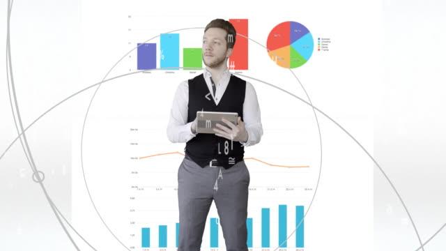 vídeos de stock, filmes e b-roll de young caucasian businessman analyzing financial charts. investment sales person looking at business data statistics - manipulação digital