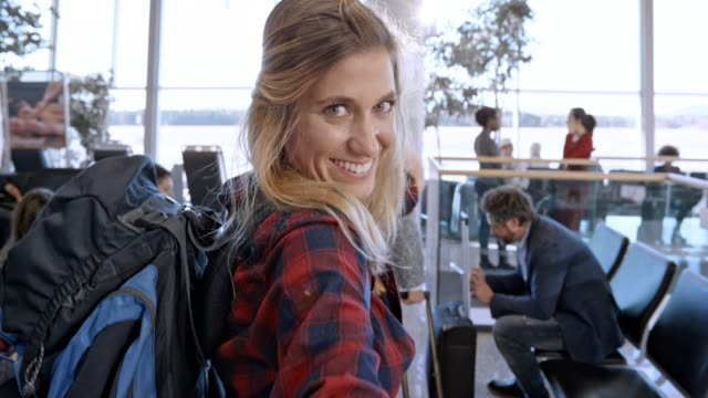 young caucasian female making selfies at the airport gate while waiting for boarding - slovenia stock videos & royalty-free footage