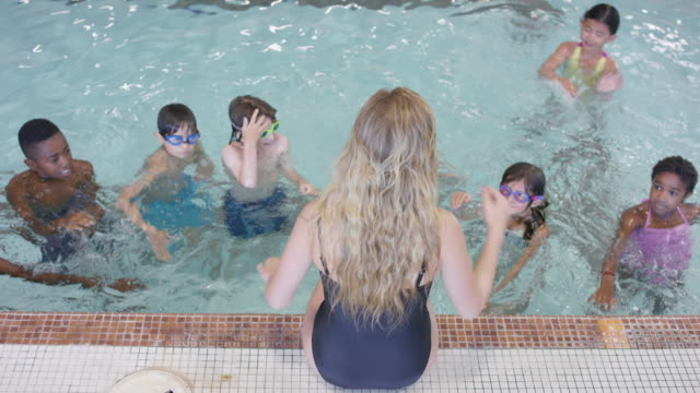 Young Caucasian Female Teaching a Swimming Lesson