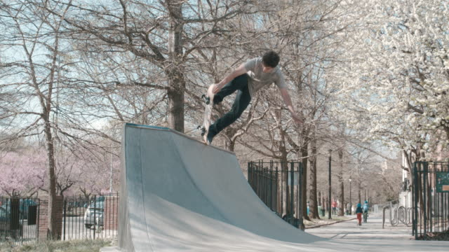 a young, caucasian male skateboards at a brooklyn, nyc skatepark - half pipe stock videos & royalty-free footage