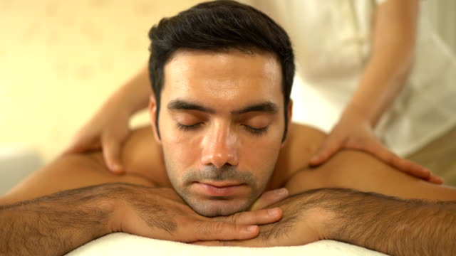 young caucasian man relax during massage - massaging stock videos & royalty-free footage