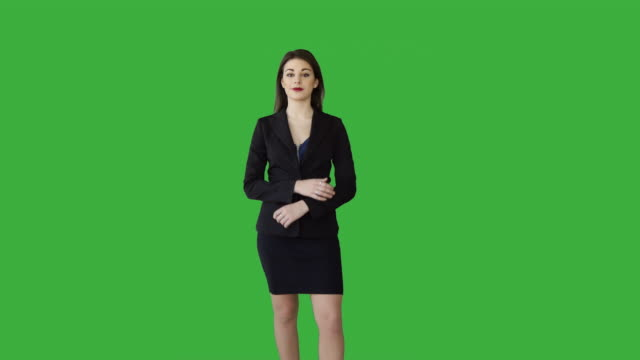 young caucasian manager standing isolated against green screen. good-looking brunette businesswoman talking in front of green background. - standing stock videos & royalty-free footage