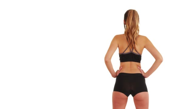stockvideo's en b-roll-footage met young caucasian woman going for jog on white background with copyspace - jogster