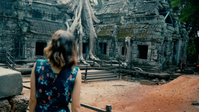 young caucasian woman   in ta prohm temple - old ruin stock videos & royalty-free footage
