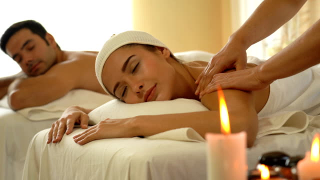 young caucasian woman relax during massage - health resort stock videos & royalty-free footage