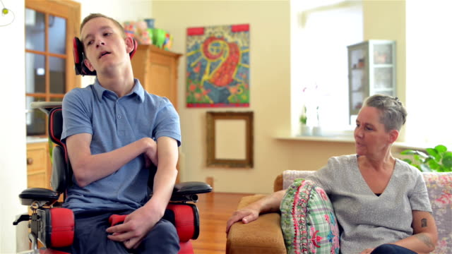 young cerebral palsy patient - physical disability stock videos & royalty-free footage