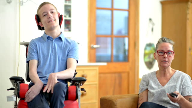 young cerebral palsy patient watching tv - disability support stock videos & royalty-free footage