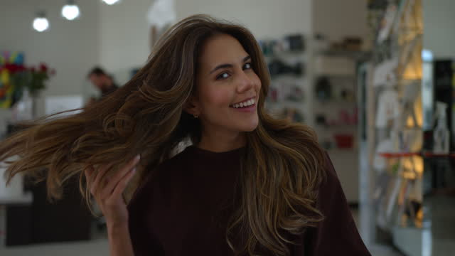 young cheerful woman at the hair salon looking very satisfied and happy with her new look - beauty salon stock videos & royalty-free footage