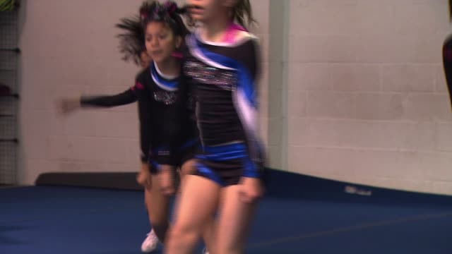 young cheerleaders tumbling - cheerleader stock videos & royalty-free footage