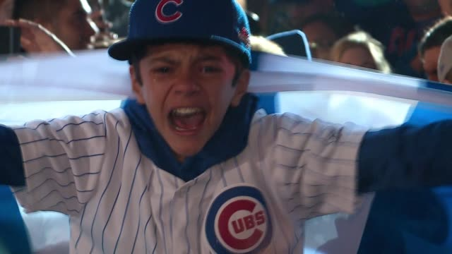 WGN Young Chicago Cubs Fan Crying Tears of Happiness in a huge crowd celebrating near Wrigley Field After the Cubs beat the Los Angeles Dodgers 50...