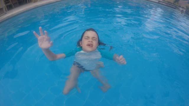 Young child in a swimming pool drowning