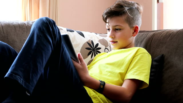 young child using digital tablet - one teenage boy only stock videos & royalty-free footage