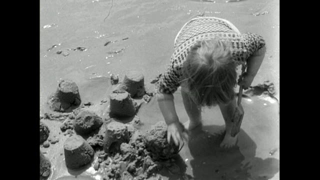 young children build sandcastles on brighton beach; 1950 - east sussex stock videos & royalty-free footage