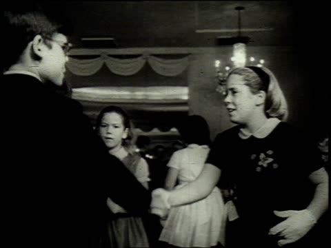 1962 montage young children doing the twist at a dance class / united states - debütantin stock-videos und b-roll-filmmaterial