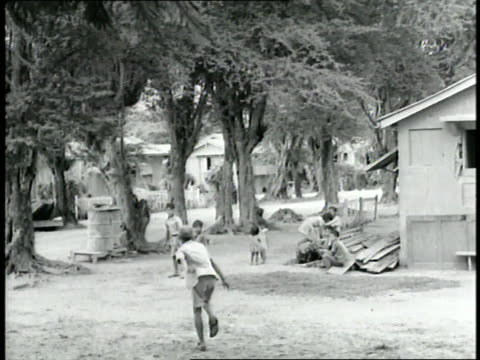 young children play stickball near a home in saipan - saipan stock videos and b-roll footage