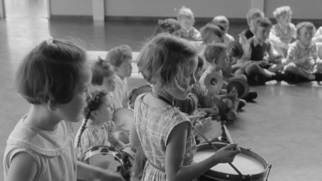 1960 montage young children playing drums and tambourines / united kingdom - performing arts event stock videos & royalty-free footage